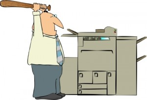 Image of Man Beating a Copy Machine